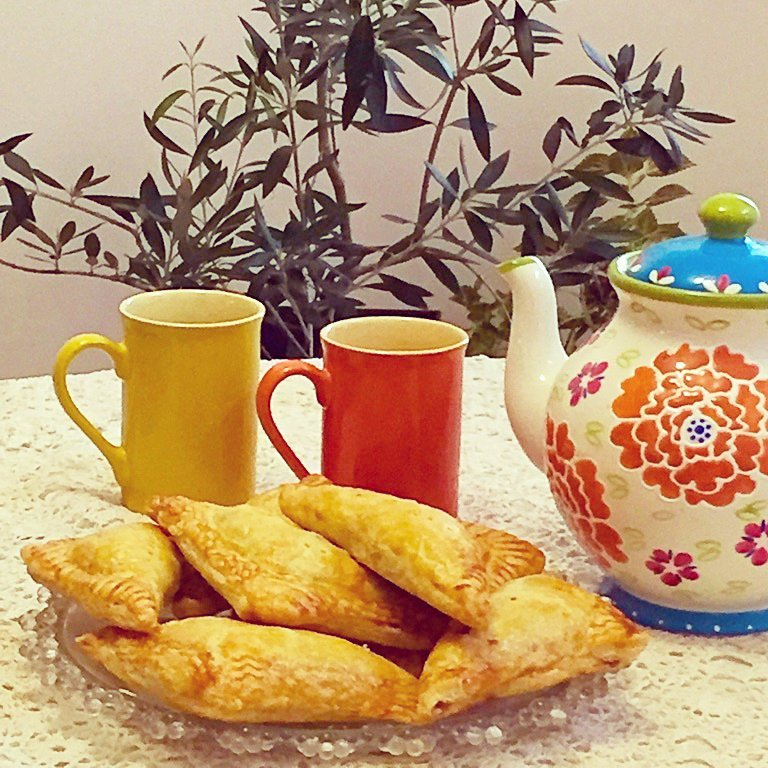 Apple turnovers with tea